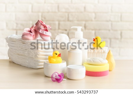 Set of baby accessories for hygiene on wooden table closeup #543293737