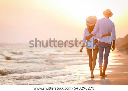 Young happy couple on seashore #543298273