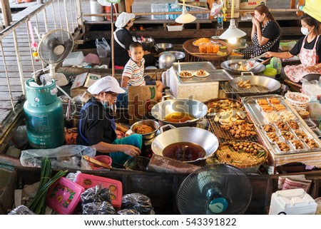 NAKHON PATHOM, THAILAND-DECEMBER 18, 2016: Wat Lampaya Floating Market Nestled along the Tha Jeen river in Nakhon Pathom province, Weekend floating market is a meeting point for the abundant food. #543391822