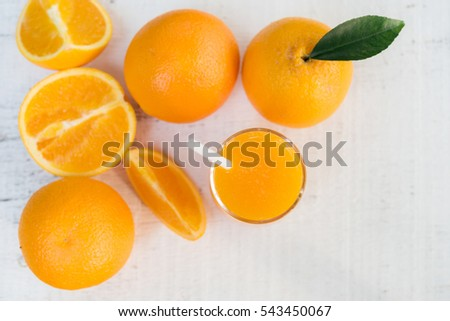 Glass of fresh orange juice from top view #543450067