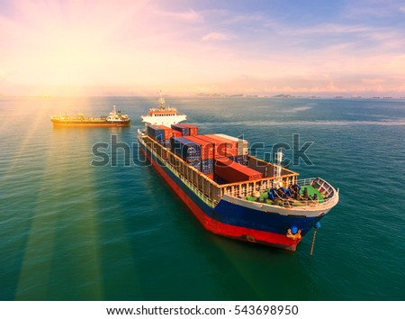 container,container ship in import export and business logistic.By crane , Trade Port , Shipping.Tugboat assisting cargo to harbor.Aerial view. Top view. #543698950