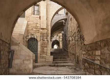 Old city hidden passageway, stone stairway and arch. Jerusalem, Israel #543708184