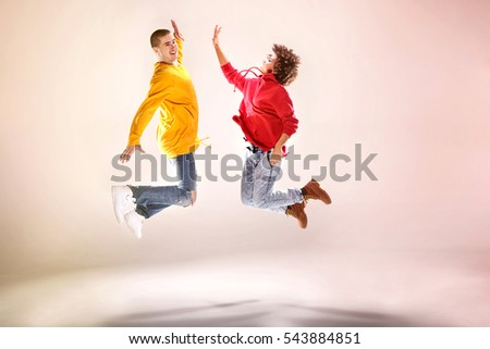 Young girl with afro dancing with boy, modern dancers. #543884851
