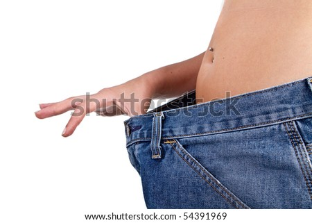 Female Model showing her lost weight by putting on an older jean. #54391969