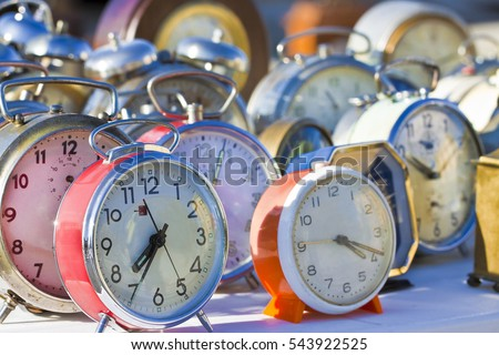 Old colored metal table clocks - concept image #543922525