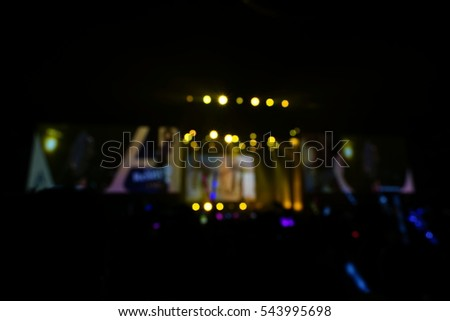 Defocused entertainment concert lighting on stage, blurred disco party. #543995698