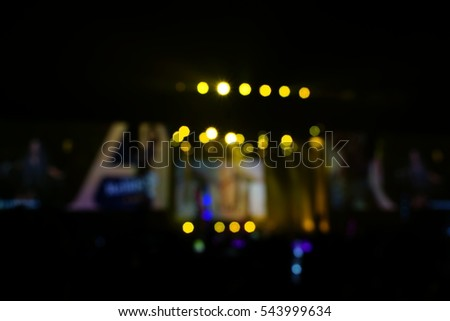 Defocused entertainment concert lighting on stage, blurred disco party.  #543999634