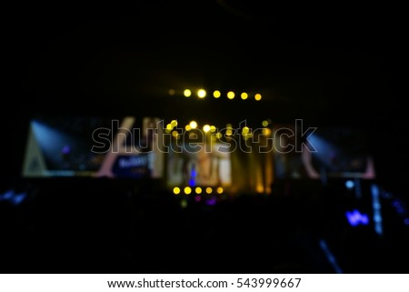 Defocused entertainment concert lighting on stage, blurred disco party.  #543999667