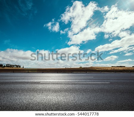 Asphalt road near water in summer #544017778