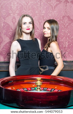 Two girls in casino around roulette #544079053