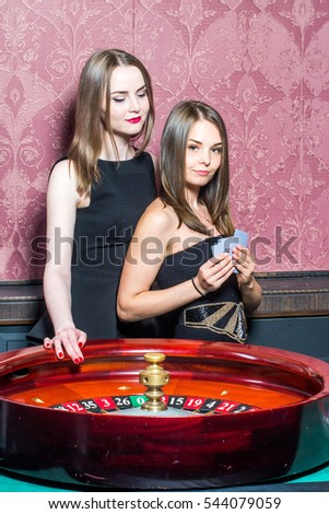 Two girls in casino with card batch #544079059