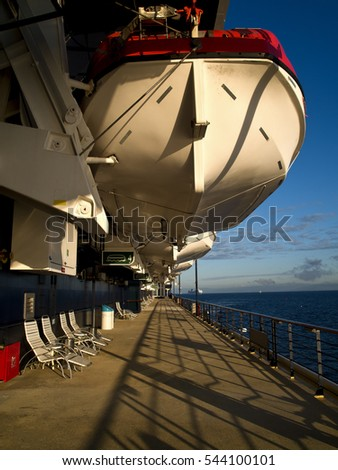 Life boat on cruise ship suspended in sunset #544100101