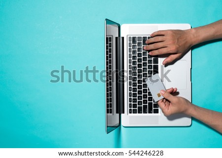 Top view of male hands making online payment Royalty-Free Stock Photo #544246228