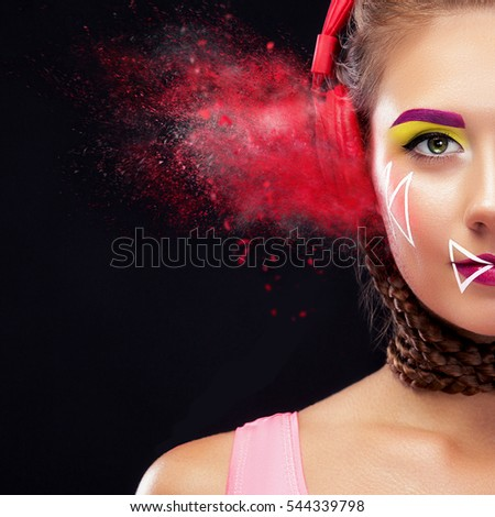 Modern young woman with art makeup enjoys listening to music in headphones. Positive emotions, leisure. Creative maek-up. #544339798