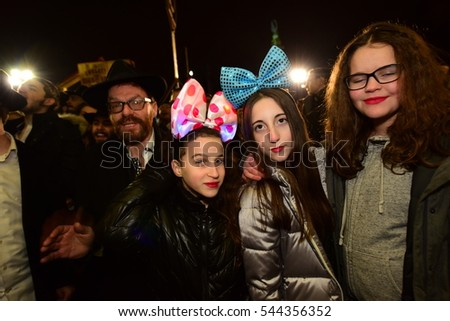 NEW YORK CITY - DECEMBER 24 2016: Chabad of Park Slope sponsored its annual giant menorah lighting in Grand Army Plaza to mark the first night of Hanukkah #544356352