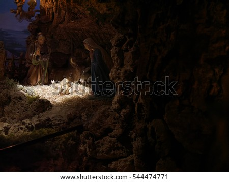 Christmas nativity scene represented with statuettes of Mary, Joseph and baby Jesus in Italy