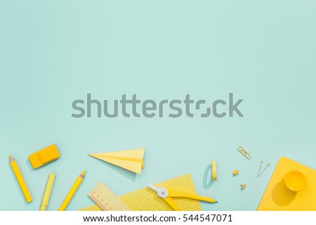 Creative, fashionable, minimalistic, school or office workspace with yellow supplies on cyan background. Flat lay. Royalty-Free Stock Photo #544547071