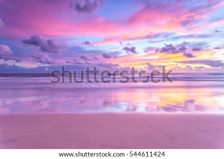 A cotton candy sunrise at the beach #544611424