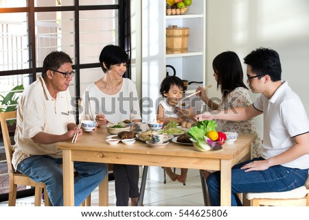 chinese family having lunch #544625806
