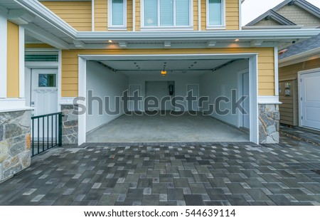 Interior of the empty garage in the residential house. Royalty-Free Stock Photo #544639114