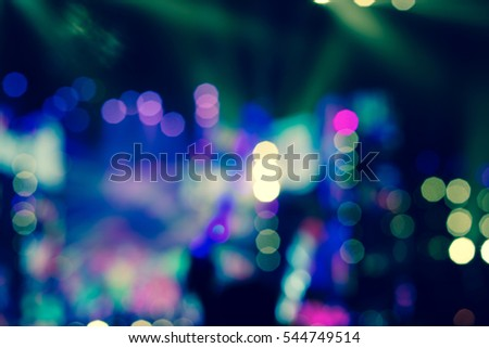 Vintage style - Defocused entertainment concert lighting on stage, blurred disco party. #544749514