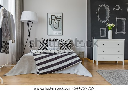 Creative modern design of woman's bedroom interior with big bed #544759969