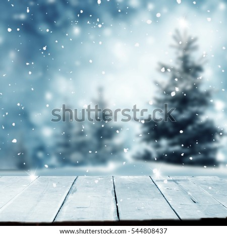 Merry christmas and happy new year greeting background with table .Winter landscape with snow and christmas trees. #544808437