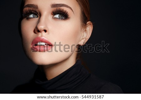 Beauty Woman Face. Closeup Of Beautiful Young Female Model With Soft Smooth Skin And Professional Facial Makeup. Portrait Of Sexy Girl With Long Fake Eyelashes And Perfect Make-up. High Resolution #544931587