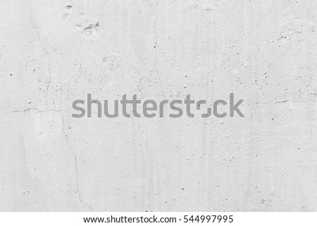 White concrete wall. Small cracks on the surface #544997995