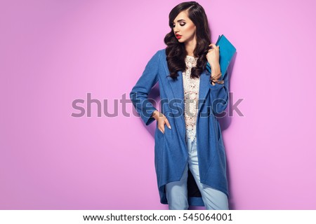 Beautiful brunette woman in a blue coat and nice top. Fashion spring autumn winter photo Royalty-Free Stock Photo #545064001
