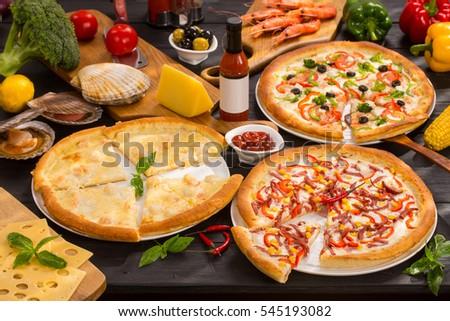 Italian pizza big set on black wooden table #545193082