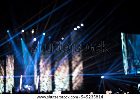Defocused entertainment concert lighting on stage, blurred disco party. #545235814
