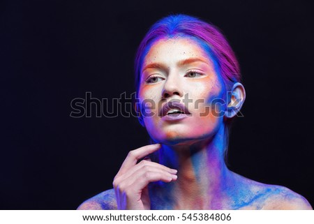 Portrait of beautiful young woman with amazing body-art #545384806