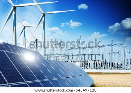 Modern electric grid lines and renewable energy concept with photovoltaic panels and wind turbines #545497120