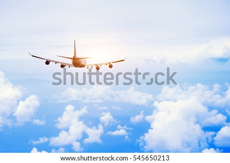 airplane fly in the sky, international passenger flight, travel concept background Royalty-Free Stock Photo #545650213