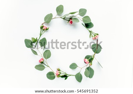 Round frame with pink flower rose buds, branches eucalyptus and leaves isolated on white background. lay flat, top view