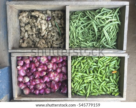 Red Onions and Green Peas display and selling on the Asan Tole Street Market in Khatmandu, Nepal. #545779159