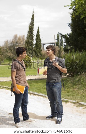 two young student talking at the school park #54601636