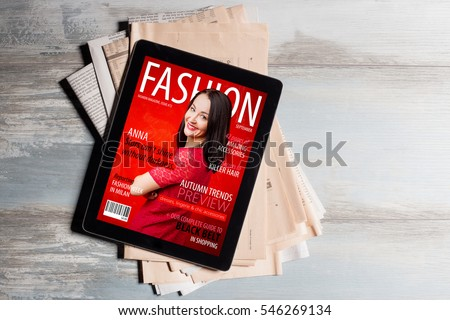 Fashion magazine cover on tablet