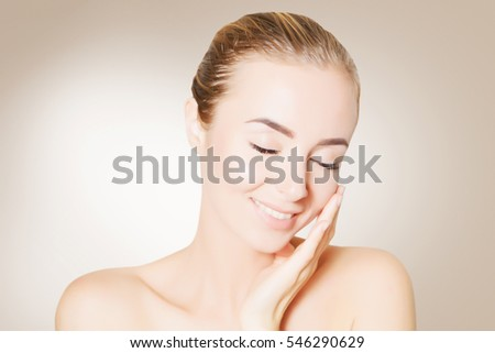portrait of beautiful smiling woman with perfect skin #546290629