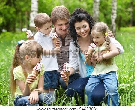 Family with kids eating ice-cream. Outdoor. #54633031
