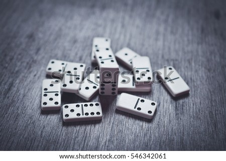Dominoes isolated on a table #546342061