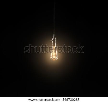 Light bulb on black background Royalty-Free Stock Photo #546730285