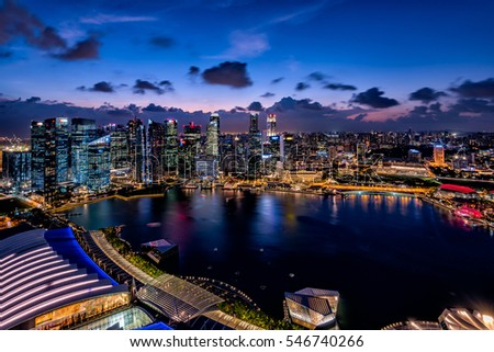 Singapore - February 18, 2016: Skyscrapers at Singapore Marina bay area. Marina Bay is a bay located in the Central Area of Singapore.  #546740266