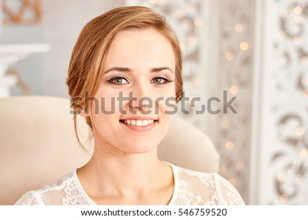 face blonde happy bride before the wedding. Portrait of a young girl with a beautiful smile. The bride smiles. Beautiful teeth.