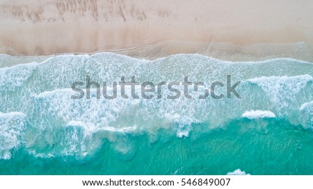 Sea Aerial view, Top view,amazing nature background.The color of the water and beautifully bright.Azure beach with rocky mountains and clear water of Thailand ocean at sunny day.flying drone,sea view #546849007