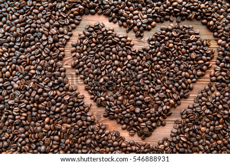 Heart shape created with coffee beans on a background #546888931