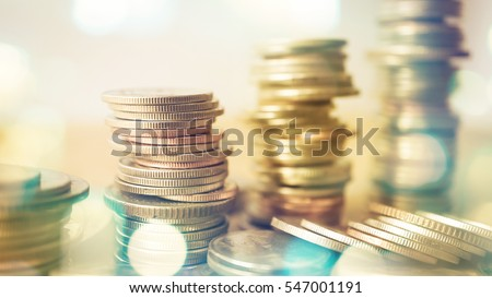 rows of coins and blurred bokeh for finance and banking concept Royalty-Free Stock Photo #547001191
