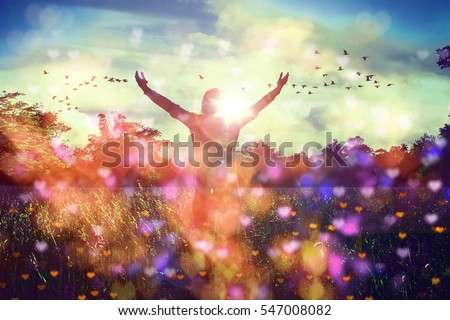 Young girl spreading hands with joy and inspiration facing the sun,sun greeting,freedom concept,bird flying above sign of freedom and liberty,heart bokeh Royalty-Free Stock Photo #547008082
