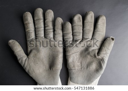 worn out working gloves against black surface  #547131886